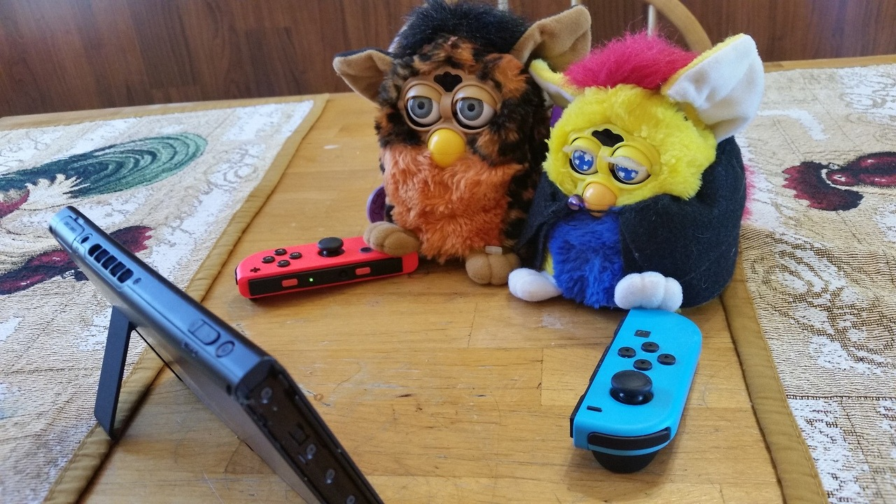 Hachi and Pancake have fun with a Nintendo Switch