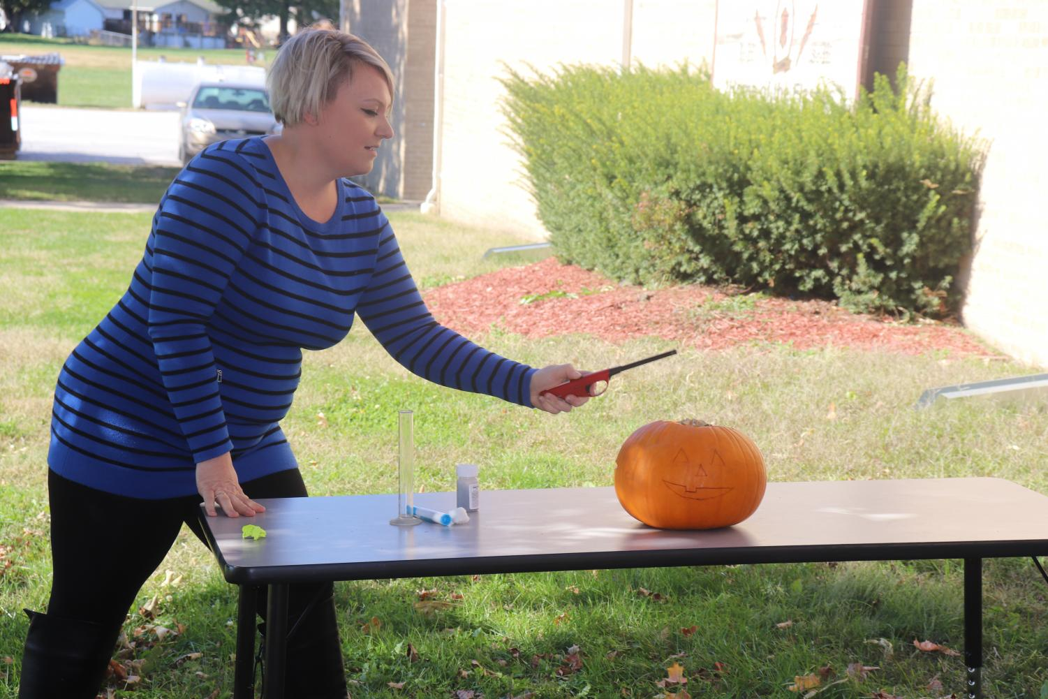 Mrs. Willhite gets ready to set off the chemical reaction during the science club meeting on Oct. 22.